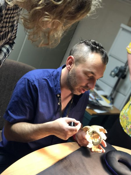 Dr. Michael Pante explaining cut marks on bone