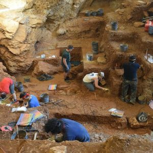 Members of the Interdisciplinary Center for Archaeology and Evolution of Human Behavior working in the cave at Lapa do Picaceiro