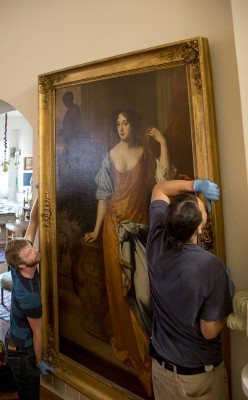 Art handlers Chris McGregor and Quentin Melveaux, from Terry Dowd Ind., move the portrait by William Wissing, Portrait of Mary of Modena Duchess of York. Oil on canvas.