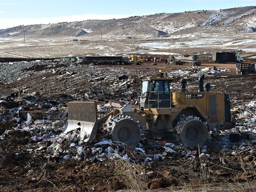 Tractor sorts trash at Larimer County Landfill.