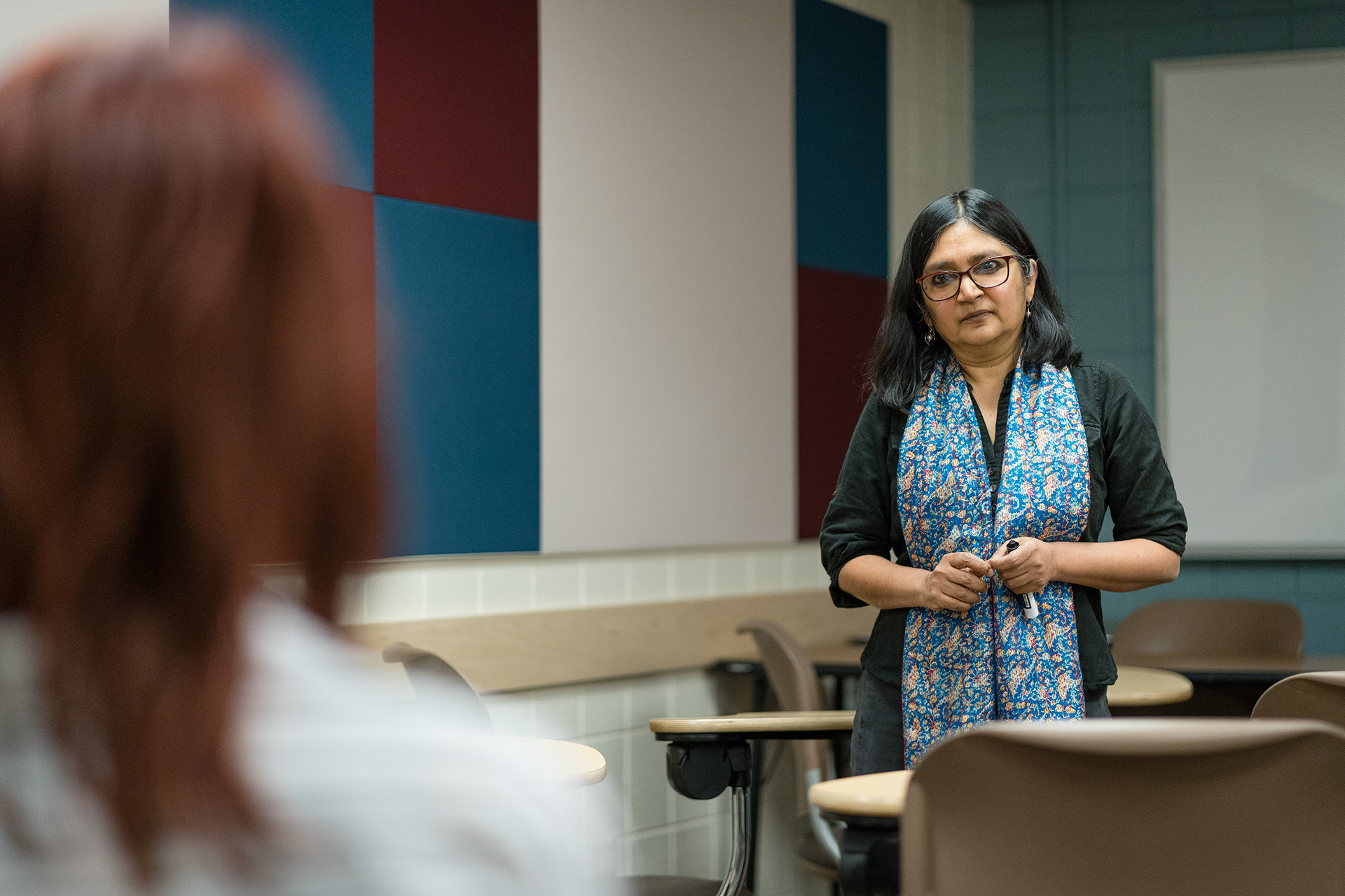 Professor Ramaa Vasudevan interacts with students in the Economics 376 class, May 2, 2019.