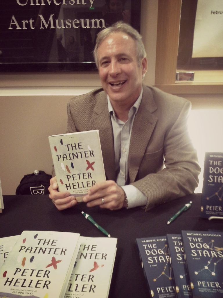 Peter Heller at the signing table with his novels, The Painter and The Dog Stars. Image by Kara Nosal.