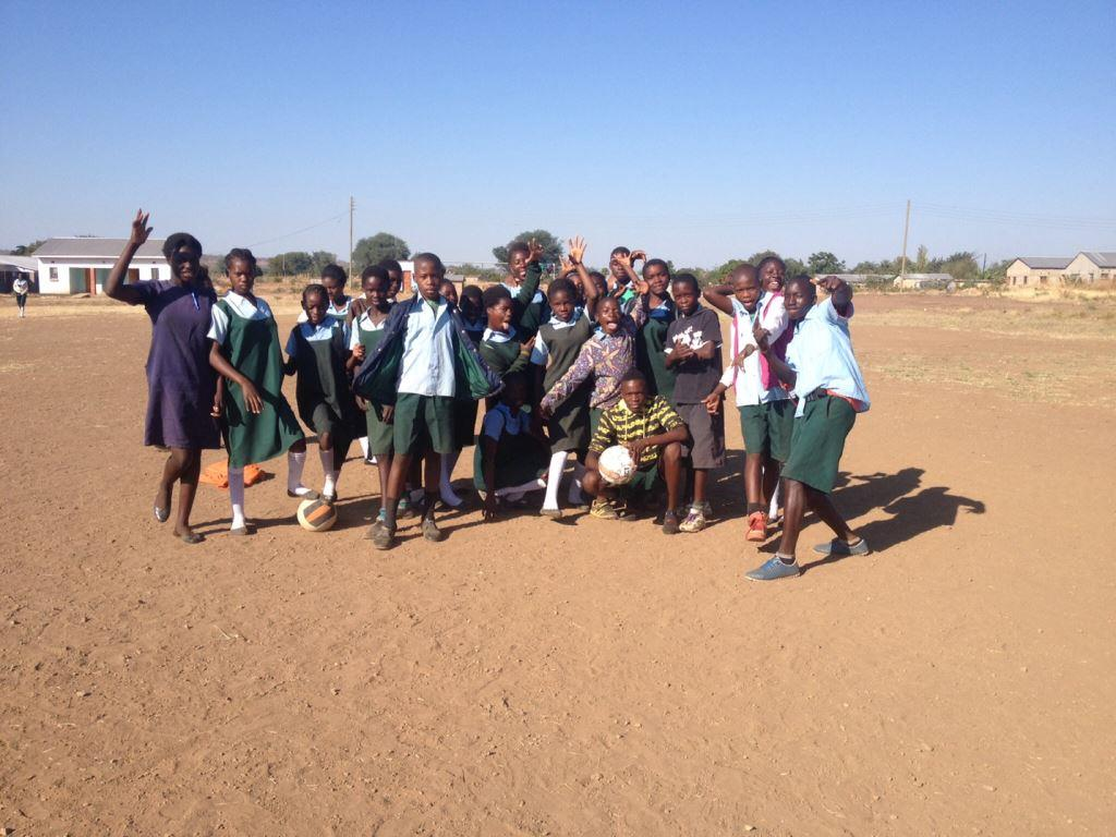 The 7th grade class at Libuyu Primary School with soccer balls donated by the CSU English Department