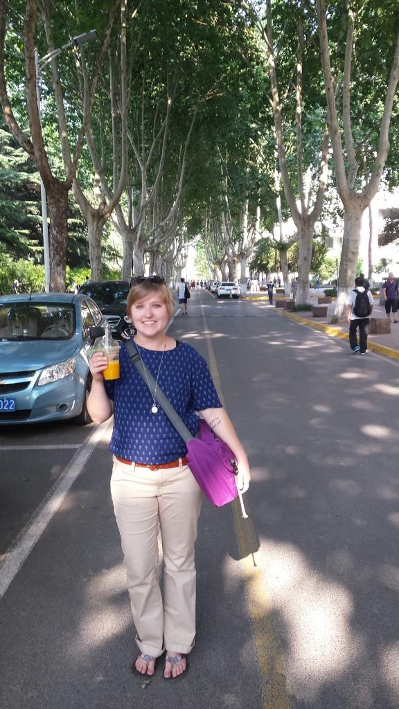"Joni says, ""I drank fresh-squeezed juice almost every day, and there was a rainbow-colored selection. This is me standing on one of the main thoroughfares on XJTU campus with a fresh mango juice. Mango and watermelon were my favorites!"""