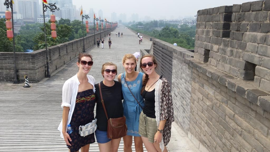 "Joni says, ""From left to right: Terran Carver, Joni Hayward, Jenna Franklin, and Kathleen Hamel. We are standing on the old city wall in this photo, which is 8 miles around."""