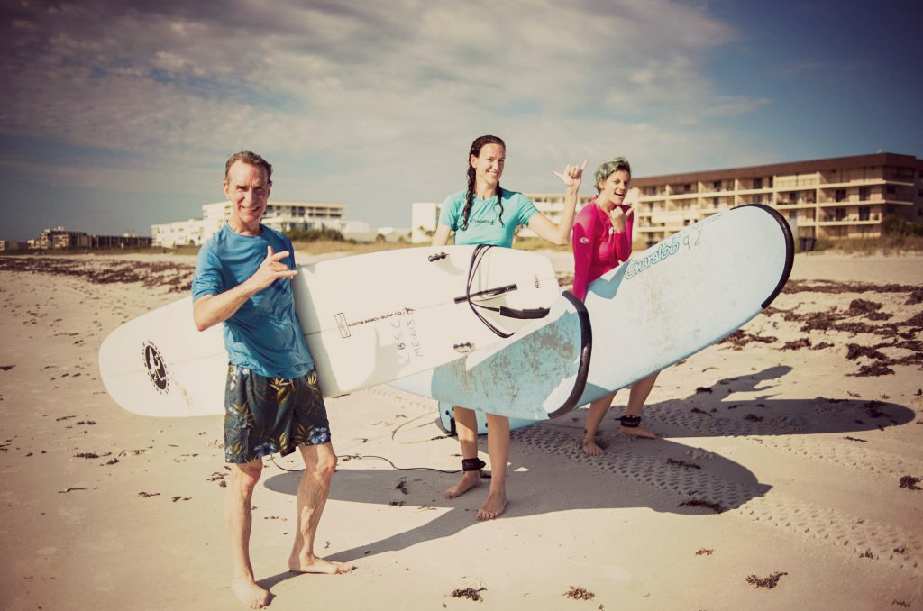 Whitney (on the far right) surfing with Bill Nye, Chief Executive Officer of The Planetary Society