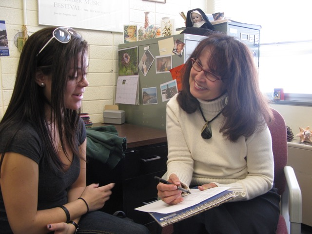 Deanna working with a student intern