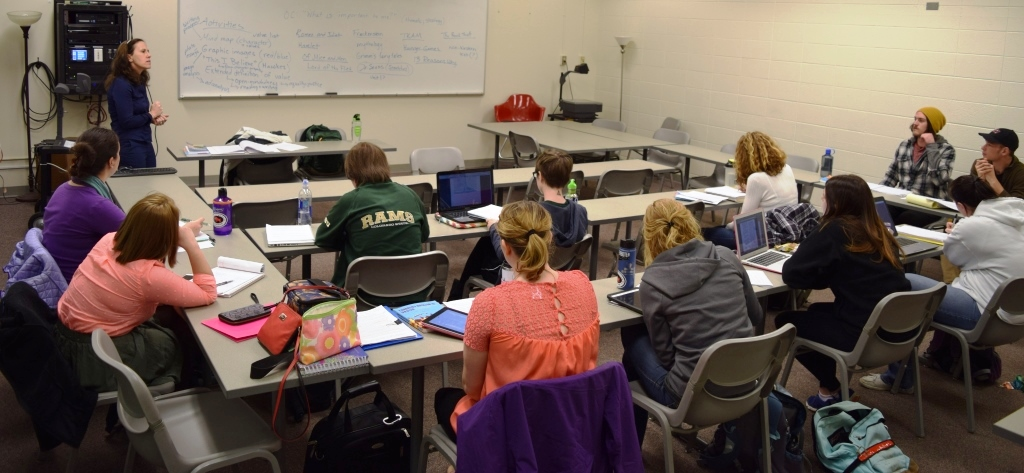 Associate Professor Pam Coke engages in a lively discussion with her EDUC463: Methods in Teaching Language Arts class