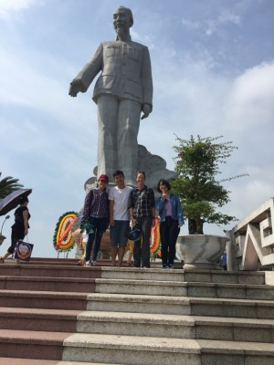 Kristie and some of her students at the base of the Ho Chi Minh statue