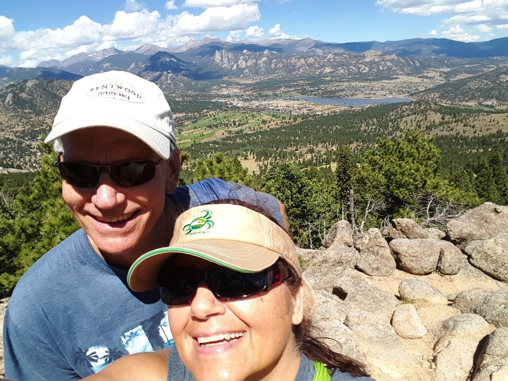 Lillian and her husband, Joel, overlooking Estes Park (hiking up Hermit);