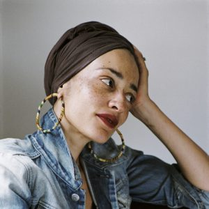 Zadie Smith looking to the side, resting her head in her hand