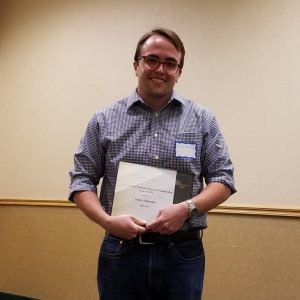 Danny Schonning receiving his award