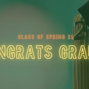 """Green overlay over a photo of a class of 2021 graduation tassel. Top row of orange neon letters reads """"class of spring 21"""" and bottom row of yellow neon letters reads """"congrats grads!"""""""