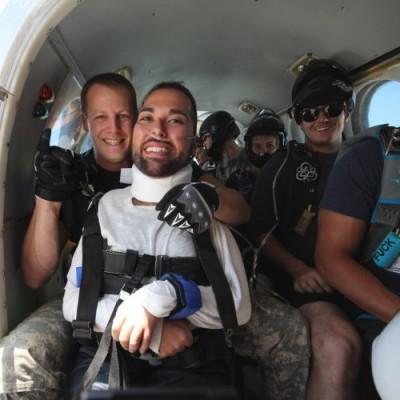 Joseph Akmakjian prepares for his first tandem jump with instructor John Mahan.