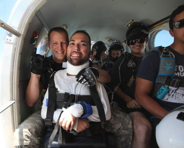 Joseph Akmakjian prepares for his first tandem jump with instructor John Mahan.
