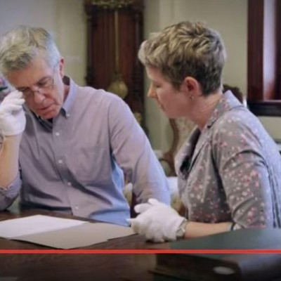"""Television personality Tom Bergeron and CSU history professor Dr. Ann Little look over documents exploring Bergeron's lineage in an episode of the TLC show, """"Who Do You Think You Are?"""" (photo courtesy of the Coloradoan)"""