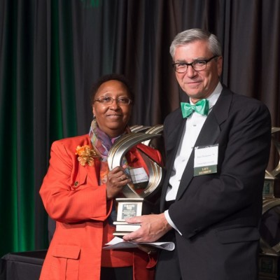 Blanche Huges receives award