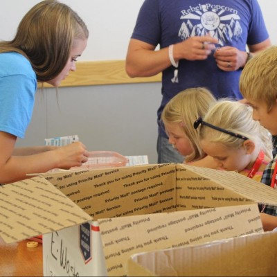 LEAP students assist participants in designing their race cars.