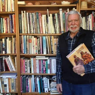 A photo of Peter Jacobs with his book collection.