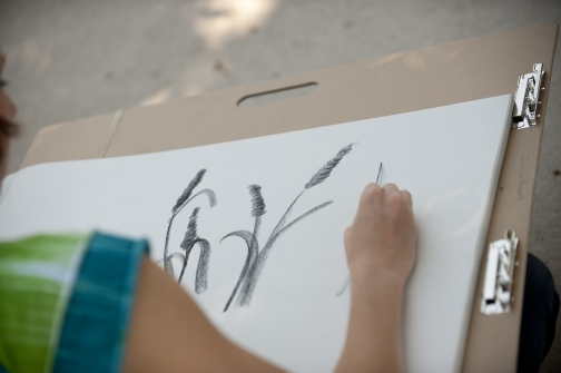 Ajean Lee Ryan, Assistant Professor of Art, gives a demonstration for her basic drawing class on the Plaza, June 22, 2010