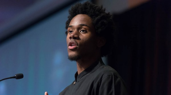 College Spoken Word winner Arisson Stanfield reads his essay at the Martin Luther King Jr. Day celebration in Colorado State University Lory Student Center Ballroom, January 18, 2016.