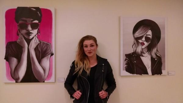 Moriah Hummer between two of her art pieces
