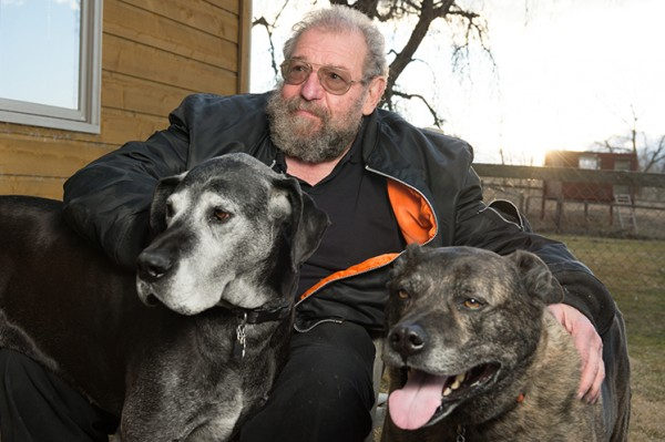 Rollin relaxes at home with his dogs, Molly and King. Photo by Bill Cotton.
