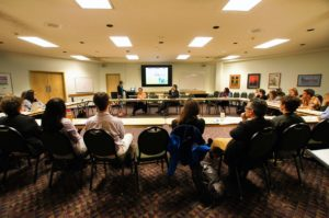 A group of students and faculty discuss campus initiative focused on environmental justice.
