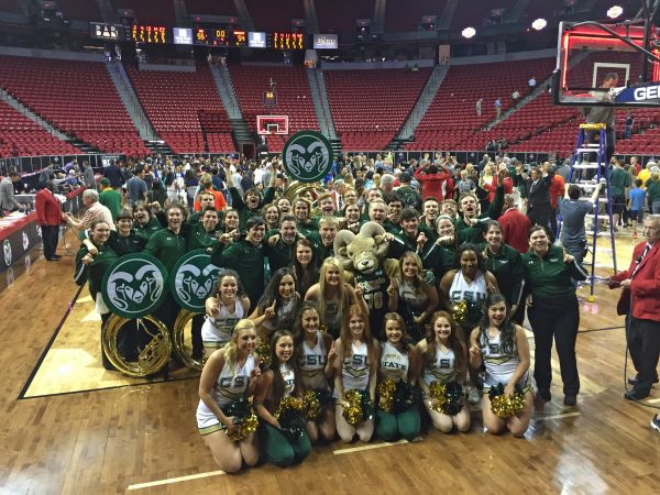 The band and Golden Poms celebrate the women's win