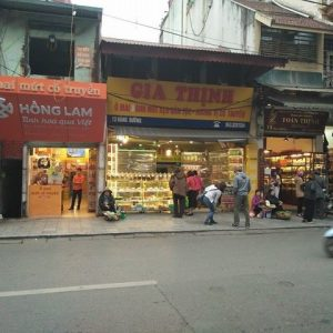 """Four sweet stores stand next to one another on ""Hang Duong"""
