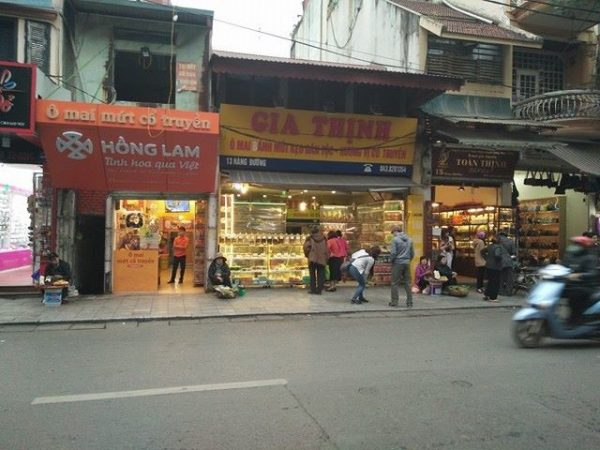 """Four sweet stores stand next to one another on ""Hang Duong"", one of ""36 streets"" in Hanoi's Old Quarter"""