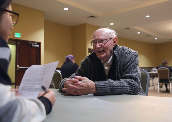 Kyu Rim Kang, a doctoral student in occupation and rehabilitation science at Colorado State University, administers a test to B Sharp participant Hal Squier before the Fort Collins Symphony concert on Saturday, Feb. 6, 2016. (Corey H. Jones/CPR News)