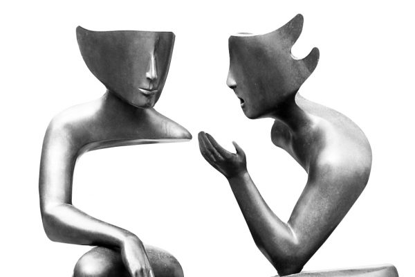 Two mannequin posed as if they are speaking conversationally to each other
