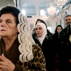 Syrian women praying at a Greek Orthodox church