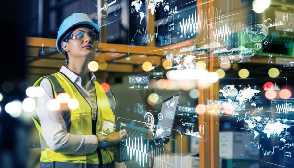 Woman programming machines to automate manufacturing processes