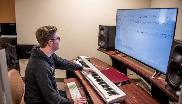 Derek Summers using the equipment to compose an original piece