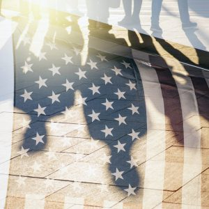 Shadows of People in a street and Flag of The USA as Background