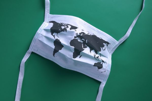 Disposable face mask printed with a map of the world