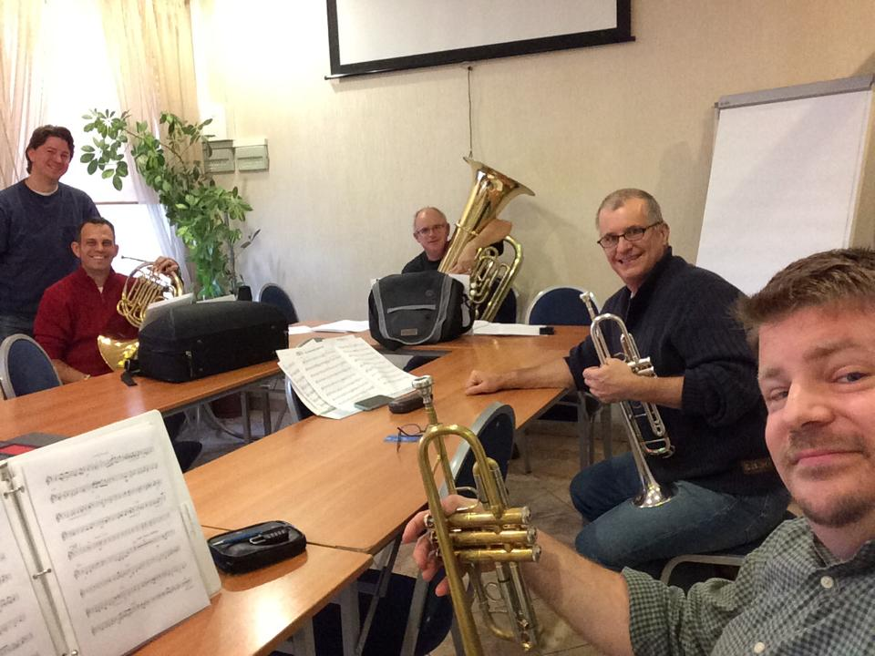 Fortress Brass rehearsing in their hotel conference room.