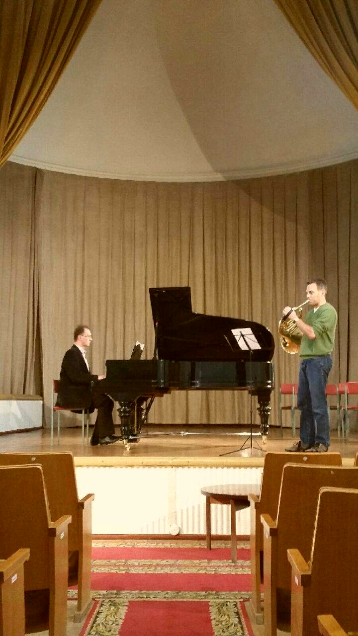 John McGuire warming up for his performance of the Telemann Horn Concerto.