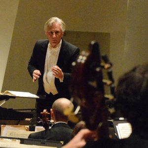 Maestro Wes Kenney pictured conducting