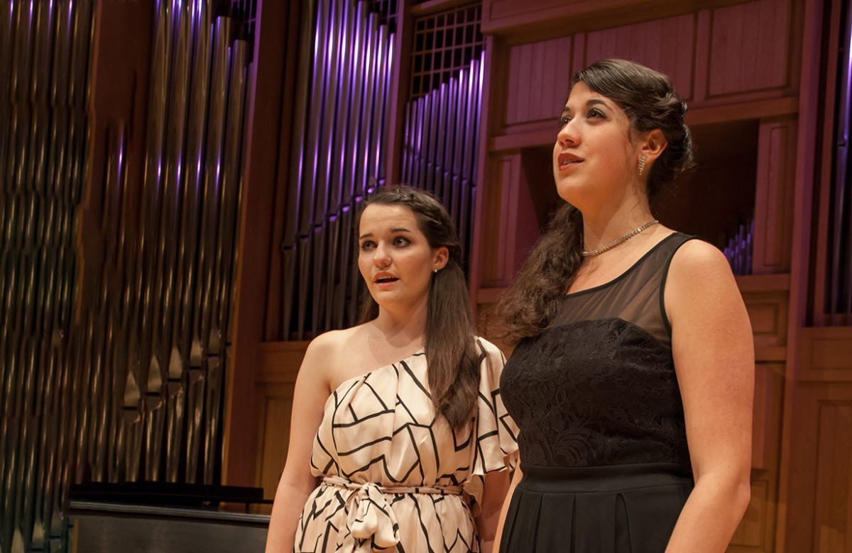 two female students singing