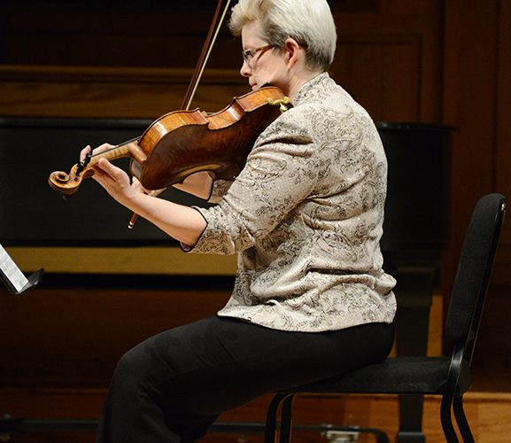 Margaret Miller pictured playing the viola