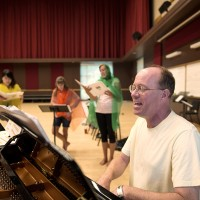 Fritz Anders (male in white t-shirt) Guest Associate Professor in the College of Liberal Arts -  Music, Theatre and Dance departments instructs students in Dalcroze Eurhythmics at the University Center for the Arts Colorado State University, August 4, 2015.