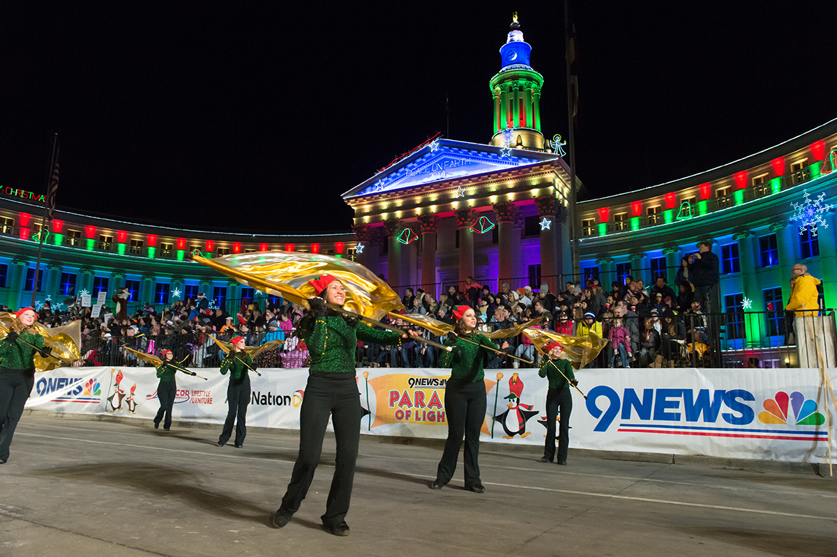 The Colorado State University Marching Band performs in the 9News Parade of Lights in downtown Denver