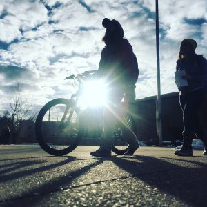 Student pictured walking a bike