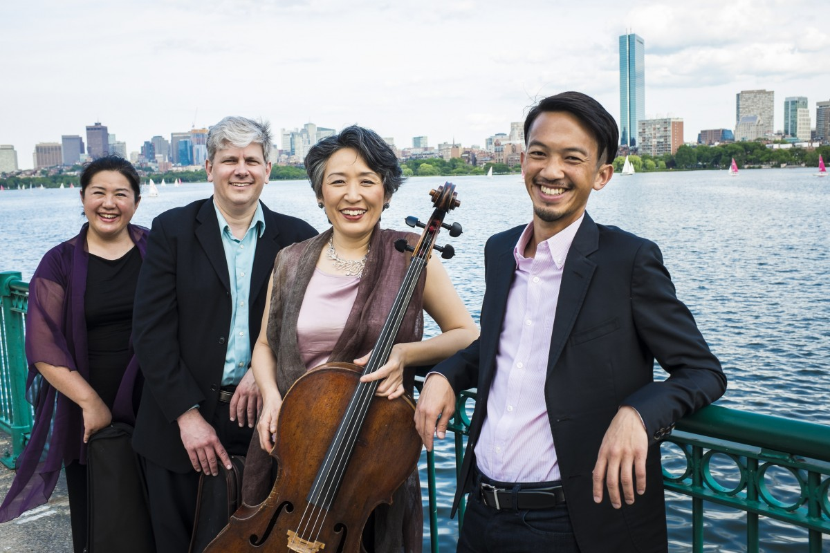 Borromeo String Quartet standing on a bridge