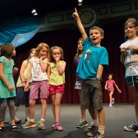 Participants in Colorado State University's Kids Do It All summer music-theatre camp rehearse their play, June 27, 2014. The annual Kids Do It All youth music-theatre program is a week-long collective creation intensive day camp facilitated by CSU theatre faculty, students and alumni.