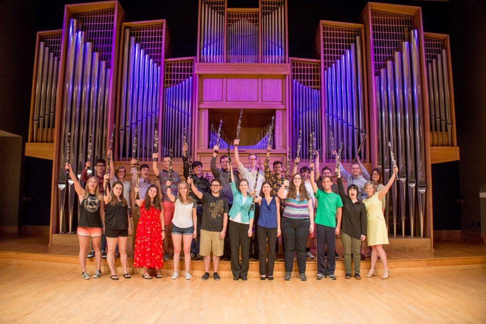 More than two dozen clarinet students and their professors pose in front of the Casavant Organ at CSU