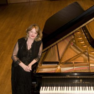 Dr. Janet Landreth pictured by a grand piano